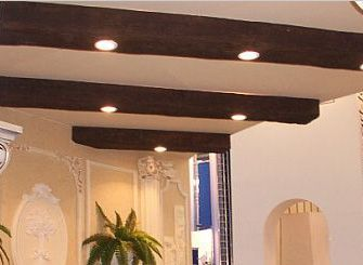 faux wood beams with recessed lighting