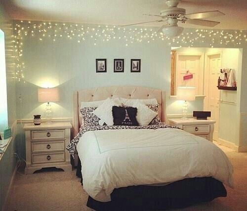 Fairy lights, white linens, and minty walls.