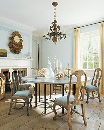 Air and Space - color, table, chairs so gorgeous  In the dining room of Jill and Daniel Dienst's weekend house, in Sag Harbor, New York, early-eighteenth-century Swedish chairs surround a contemporary table. Linen drapes and stripped floors contribute to the spare look.