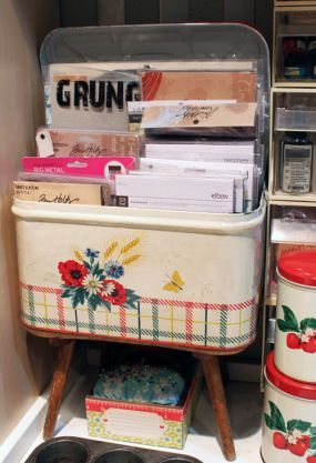 vintage bread tin for stationary storage close at hand...stationary and notecards, pens, postage stamps...all in one place!