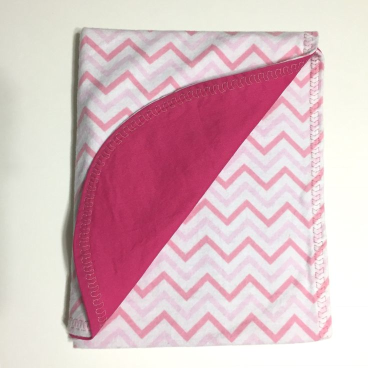 """Cute as a Button Simply Sweet Baby Blanket - Pink Chevrons. You will fall in love with this Simply Sweet Baby Blanket. Modern pink chevron print with decorative stitching, made of a soft flannel with 100% cotton on the opposing side. May be used on either side. This baby blanket lays flat in the crib. It is also perfect as a baby or toddler lap blanket, or play mat for tummy time. Simply Sweet Baby Blankets measures 30""""x40"""". All fabrics have been pre-washed for shrinkage. May machine wash…"""