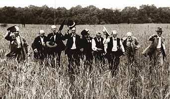 These men are a part of 50 Southerners who showed up at Gettysburg in 1913---- on the 50th anniversary of the battle. They survived the war, of course. But neater still, they are walking up Pickett's Charge, where they walked 50 years before and survived! And there weren't many of those even in 1863.