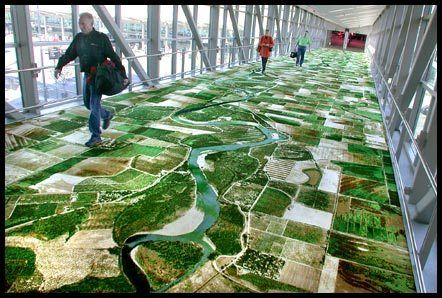 """Aptly named """"The Flying Carpet,"""" this installation by Seyed Alavi takes satellite images of San Francisco and places them on a nylon carpet at the local airport."""