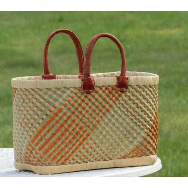 "Fair Trade basket handcrafted of a combination of raffia palmleaves and mountain gras. The plaiting gives an extraordinary beautiful structure, this handicraft is called ""rariboka"".Double sewn handles of ecologically tanned leather. Lined with beige cotton textile."