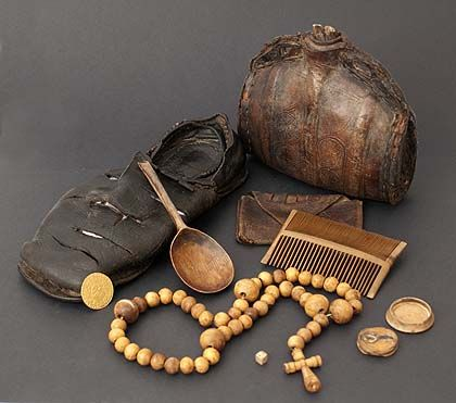 A group of Tudor objects recovered from the Mary Rose, including a leather shoe, comb, spoon, and rosary beads. 1545