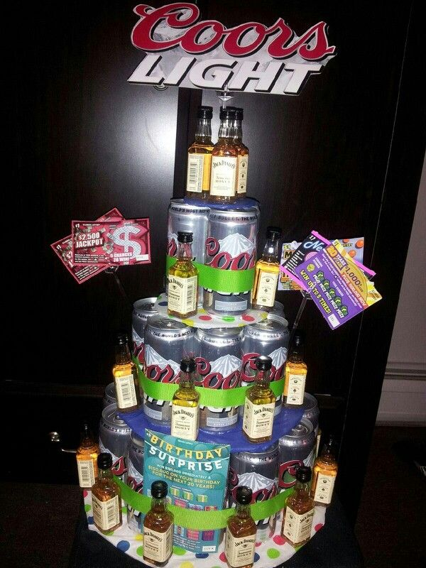 Beer cake I made out of a case of Coors light cans and Jack Daniels honey shooters. Made it for randys surprise 29th party!