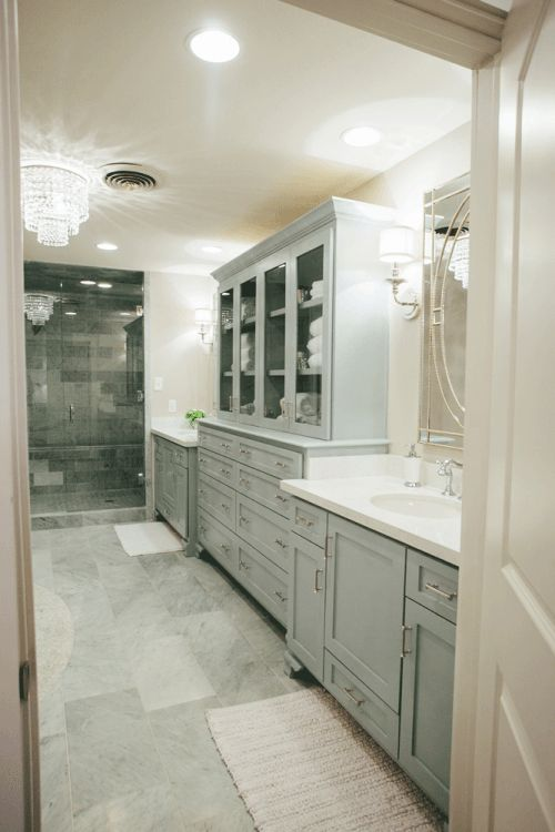 The bathroom was originally long, awkward and skinny, making it both inconvenient and bland. Chip and Joanna designed and installed a new custom vanity, free standing tub, shower and all new light fixtures and hardware. Several antique and feminine elements were added to accentuate the character and life in the room, making it a space the clients would enjoy being in.