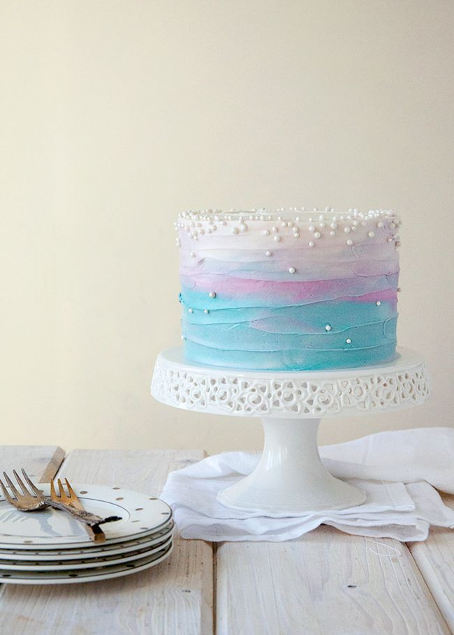 This ombre blue, purple, and white cake with edible pearls would be so perfect for a Shimmer and Shine birthday party. It captures the colors of the show, and looks just like the clouds and sky of beautiful Zahramay Falls!