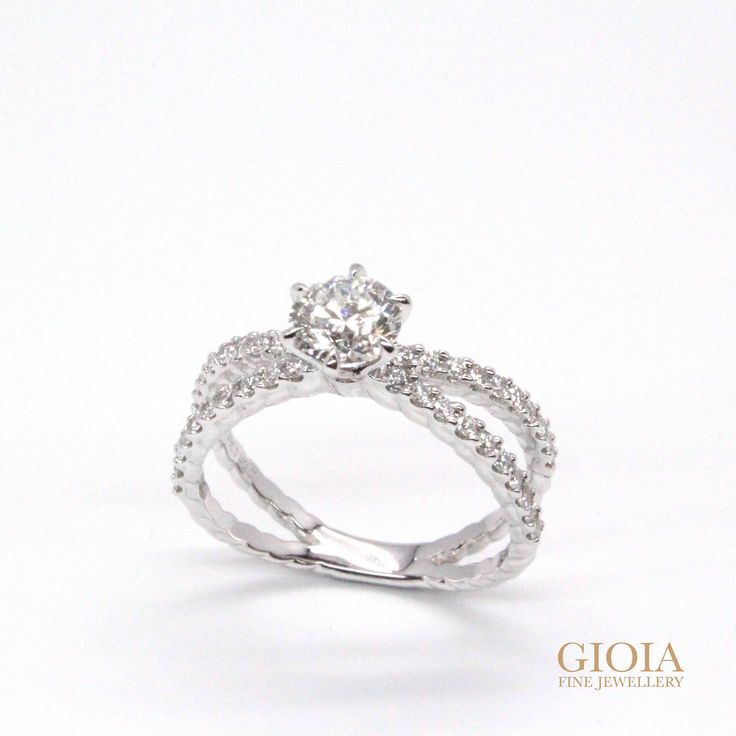Congratulation to Ian and Karen!  Round brilliant solitaire diamond, custom set with criss-cross dual band ring.  Where two hearts unite for a single beating, we wish both an everlasting love and a lifetime of happiness! Thank you for having GIOIA Fine Jewellery, in the making of this unique and one-of-a-kind proposal ring.  https://gioia.com.sg/unique-diamond-ring/