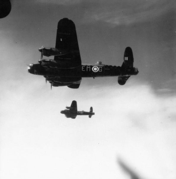 "JUL 21 1942 Churchill: ""severe, ruthless bombing of Germany"" needed Two Avro Lancaster B Mk Is, R5509 'EM-G' and R5570 'EM-F', of No. 207 Squadron RAF based at Bottesford, Linclonshire, in flight. Both aircraft were eventually lost on operations, R5509 while minelaying in the Baltic on 17 August 1942, and R5570 which crashed near Milan while on a night bombing raid to Turin on 9 December 1942."