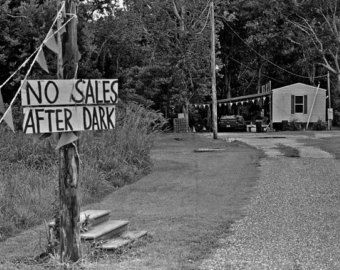 There are no sales after dark along Route 1 south of New Orleans- a black and white photograph in a southern gothic place