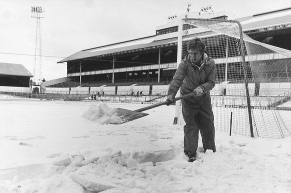 A groundsman at White Hart Lane, the football ground of Tottenham Hotspur clears snow from the pitch in 1979!