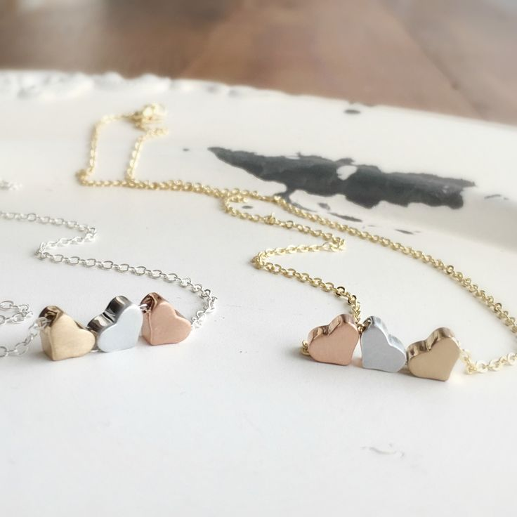 FREE NECKLACE!  Receive a free triple heart necklace with the purchase of any item in our shop.  Choose from silver or gold.  coupon code... freegift