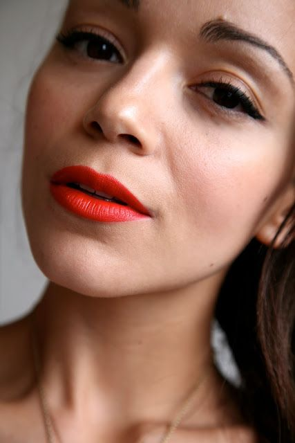 Ring My Bell: MAC 'Lady Danger'. My favorite lipstick at the moment. It's a very orangey red and it can wash me out in certain lights so I just carry a torch around with me.... JOKING!!!