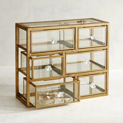 Your jewelry is too precious to be hidden away. Show it off and store it safely in our glamorous, mixed-media jewelry box. Crafted by hand of glass and gilded cast iron, it's fabulous, functional and reassuringly rust-resistant.