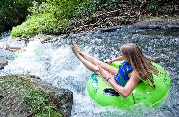 River Tubing, Jamaica || On Chukka Caribbean Adventures' White River Tubing safari, you can bounce down rapids or float lazily through an old coconut plantation and beneath arching bamboo. Island Routes' River Bumpkin Tubing Adventure includes rapids, a rope swing, and a pedicure by your guide using the river's natural limestone.