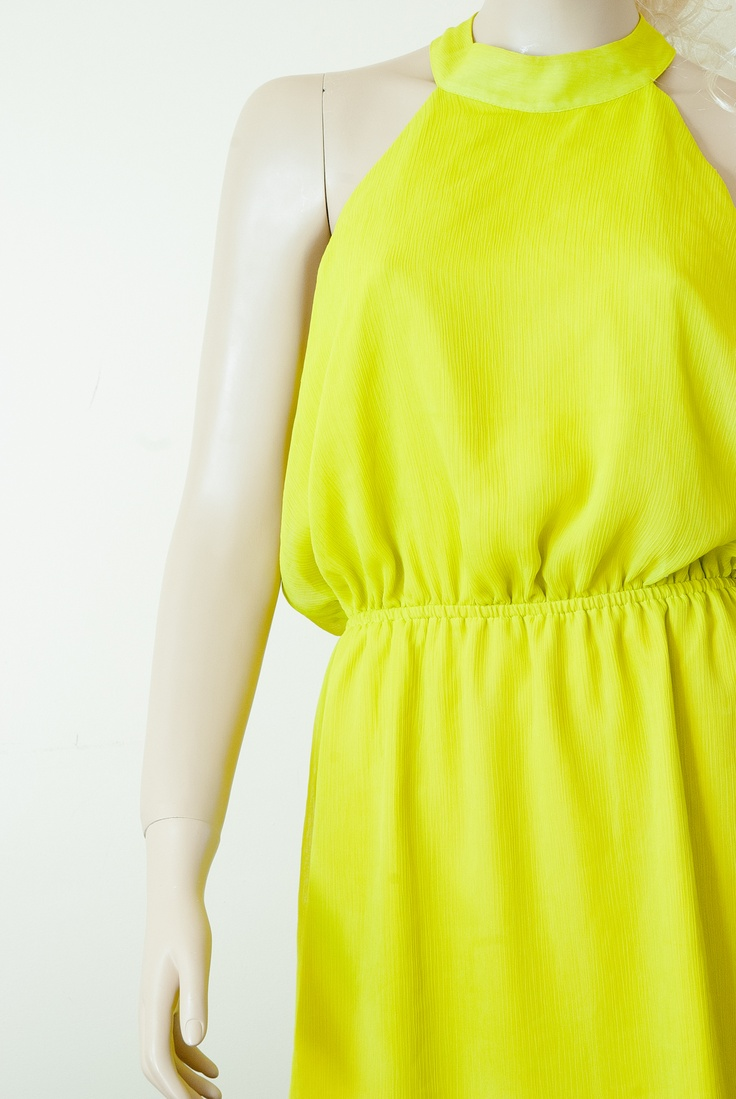 Beautiful new cocktail dress in the color of lemon grass. Up in the shape of a loop on the back of tense two buttons on the neck in the shape of teardrops.