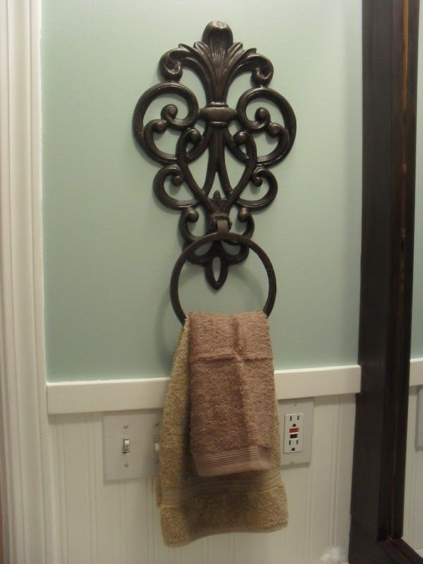 The hand towel rack is actually a wrought iron flower pot holder.  It was an off-white, but I spray painted it with Rustoleum's oil rubbed bronze.