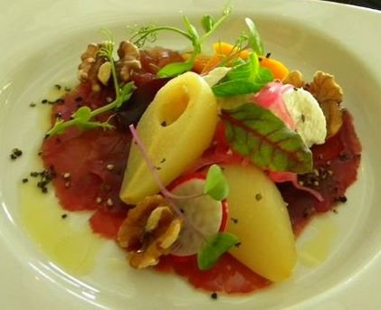 Lightly smoked Carpaccio of Springbok with pears, goats cheese and walnuts