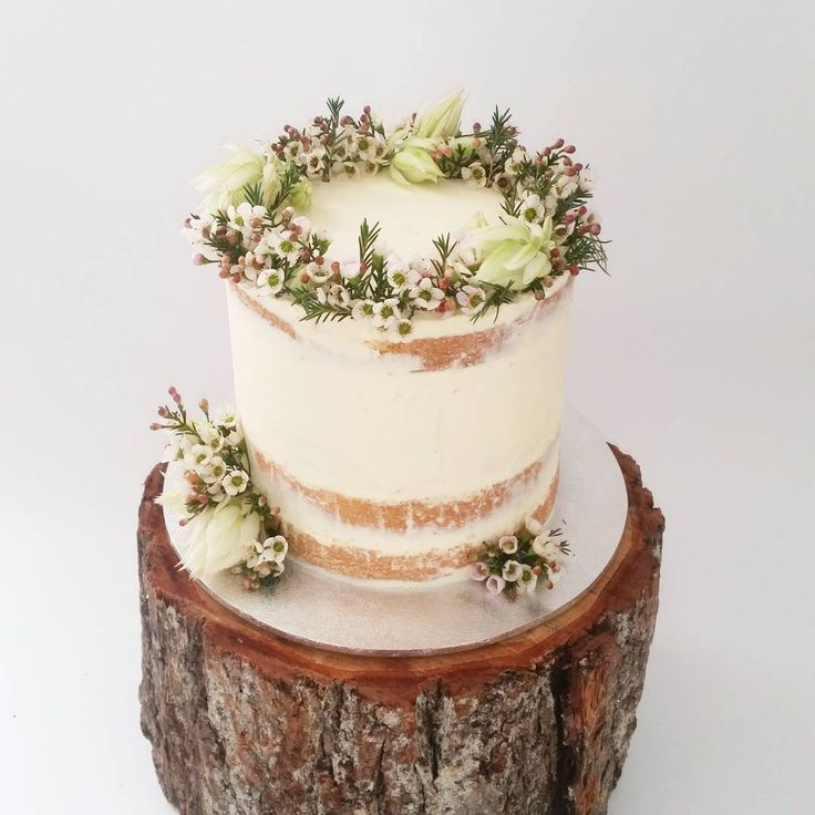 """""""Blushing brides & geraldon wax flowers on a semi naked for a woodland theme…"""