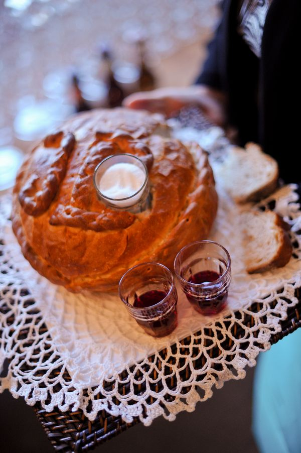 "Polish Wedding Ceremony Tradition   'sharing of bread, salt, and wine.' The bread means ""may you never go hungry."" The wine means ""may you enjoy the sweetness in life."" The salt is to overcome the bitterness in life. A silver coin signifies wealth a good health."
