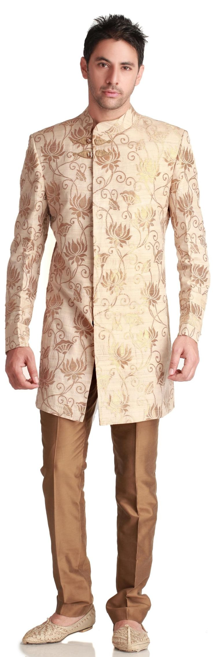 For the Glam groom, who isn't afraid of the spotlight: draw all eyes on him with this Virtues woven-gold-and-cream sherwani ($655.00), with off-centered clasps. Comes with fitted, bronze-gold trousers.