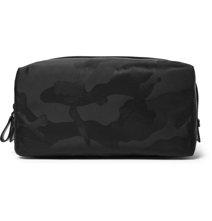 Next time you travel whether for work or pleasure, gather your grooming essentials in <a href='http://www.mrporter.com/mens/Designers/Valentino'>Valentino</a>'s camouflage-patterned wash bag. Made from hard-wearing jacquard that can be easily wiped clean, this piece has a soft construction but is reinforced with a sturdy leather base and trims. It's the ideal size for stowing in a weekend holdall.