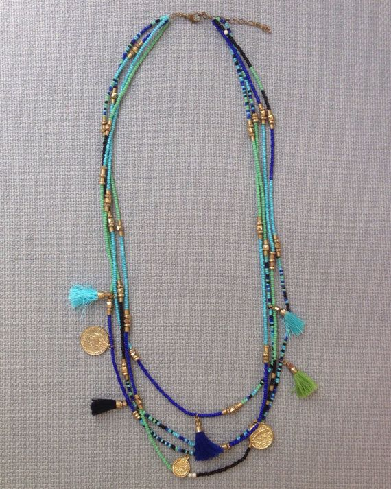 Spice your outfit up with this boho bohemian inspired turquoise, blue, and green seed bead charm tassel statement necklace. Necklace Measurements: -