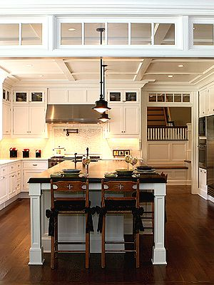 Transom between family room and kitchen for room definition