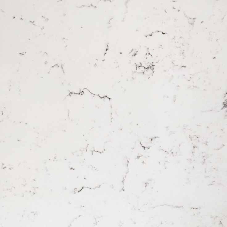 This is the attractive Carrera. It is a pure crisp white that centres around an eye catching grey subtle marble effect.