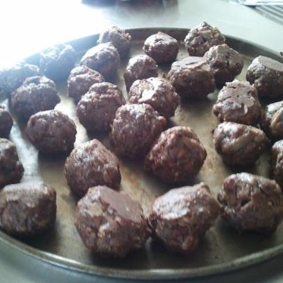 Just put some cacao balls together - almond meal, flaked almonds, goji berries, black chia seeds, cacao powder, brown rice puffs, pinch of celtic salt and maples syrup. Melt coconut oil and add enough to make a sticky mess. No measurements just use your own judgement. You really can add anything. I would have put in shredded coconut but didn't have any. Should be fairly firm. With damp hands mould into little balls, pop on a tray and put in the fridge to set. Yum Yum in my Tum (and the kids)