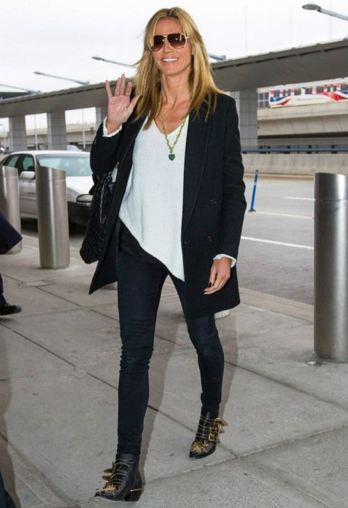 Heidi Klum wearing Chloe Susanna Boots, Helmut Lang Asymmetric Sweater and Chanel Large Quilted Lambskin Tote with Exterior Pocket.