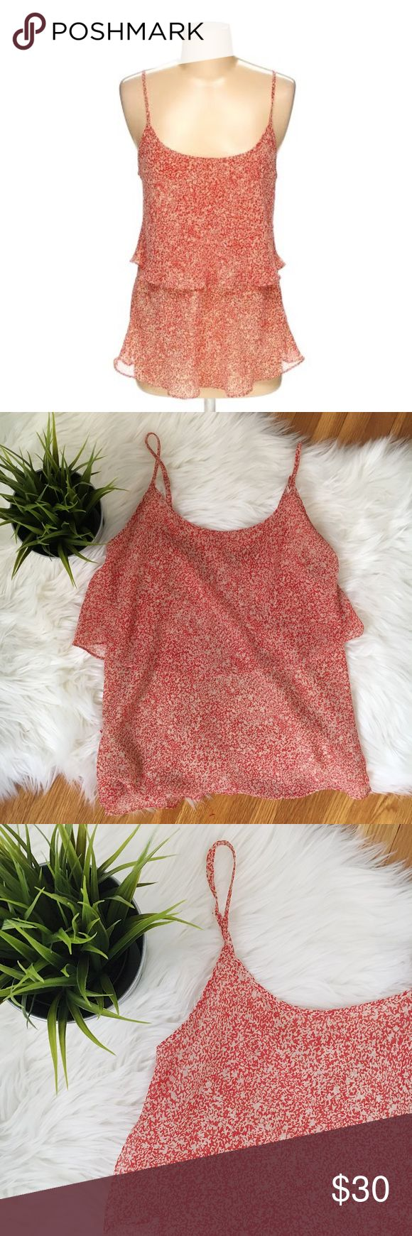 Cabi cami w/ adjustable straps & layer of ruffle Cami brand  Size x-small  Adjustable straps  Excellent condition CAbi Tops Camisoles
