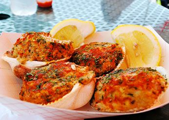 Stuffies.  There are many variations, but your basic stuffy is chopped quahaugs, bread crumbs, and herbs baked in the shell and served with lemon or hot sauce.  We love 'em!