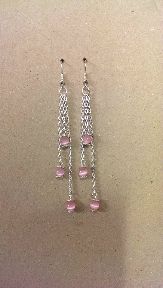 A pair of Cats Eye Gemstone Earrings with chain and daisy spacer beads.