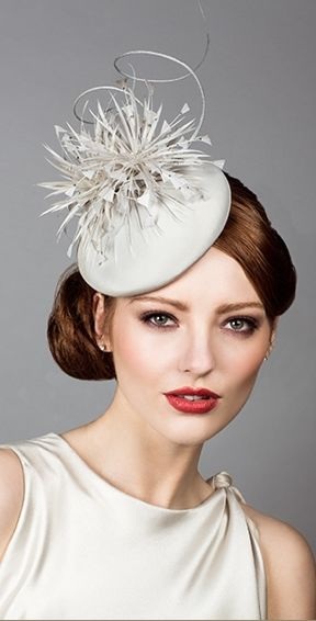 Rachel Trevor Morgan, S/S 2014. Silk taffeta pillbox with spike feathers and diamante. #passion4hats
