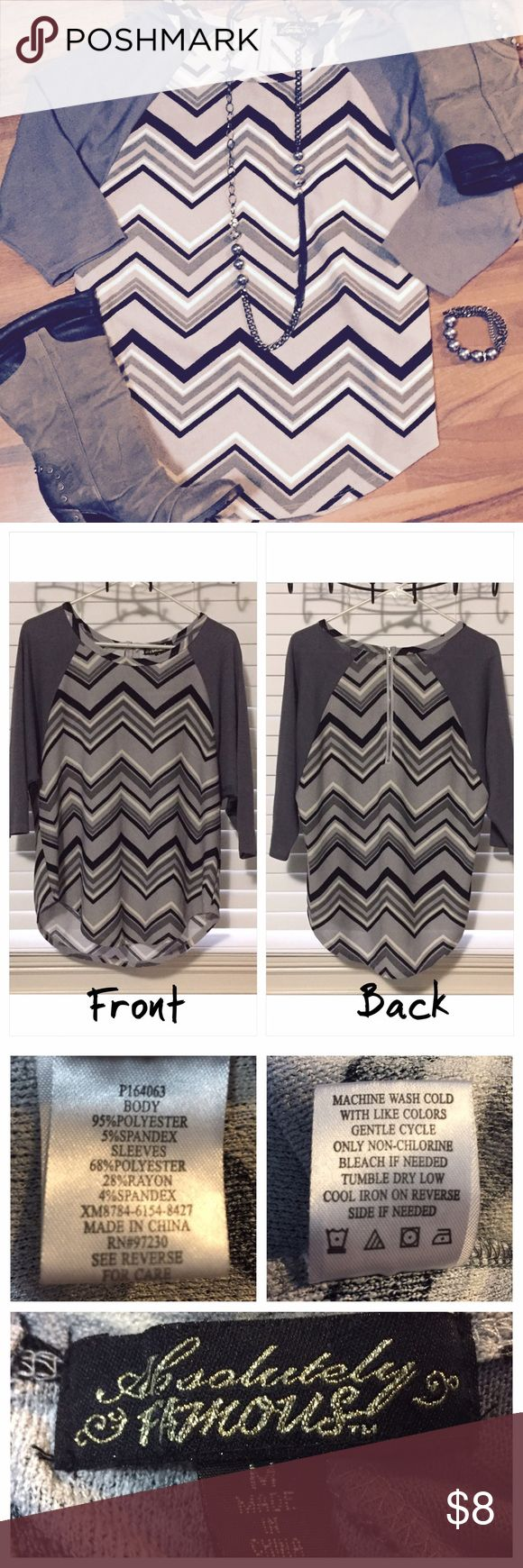 Absolutely Famous | Chevron Top Gently used but there is a tiny fabric pull on the front that I just couldn't figure how to get out. This is a loose fitting blouse with dolman sleeves. Cheap to good home! Absolutely Famous Tops Blouses