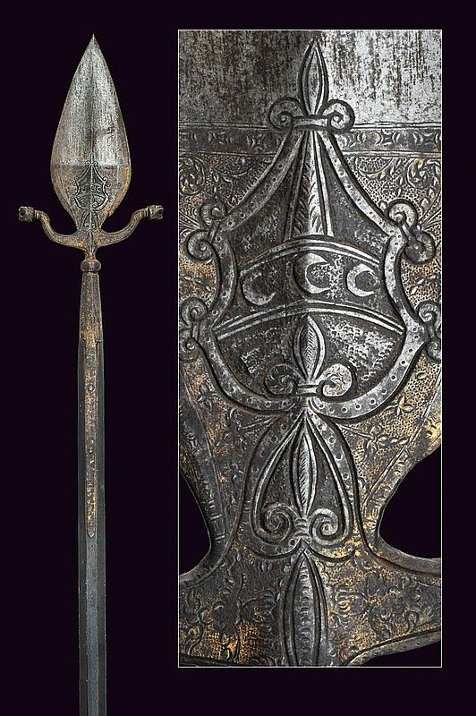 A linstock halberd, dating: mid-16th Century  provenance: Italy