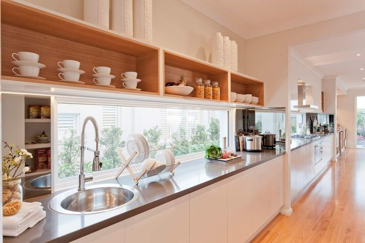 Glass window splashback. Love the long kitchen need overhead storage though.