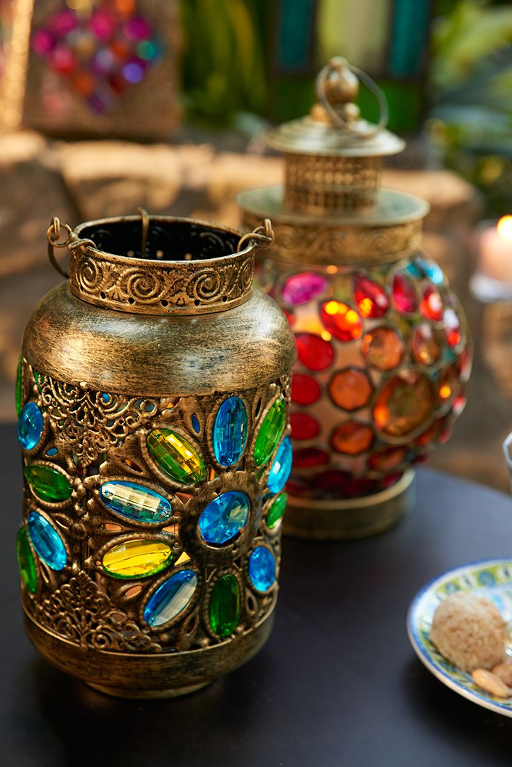 Set with brilliant-colored gems arranged in a fun floral pattern, Pier 1's exclusive handcrafted Caravan Gem Lanterns promise to make spectacles of themselves—in the best possible way. They create an enchanting ambience with or without candles.