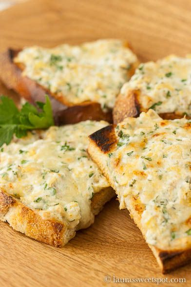 Goat Cheese & Gruyere Artichoke Toasts via Laura's Sweet Spot