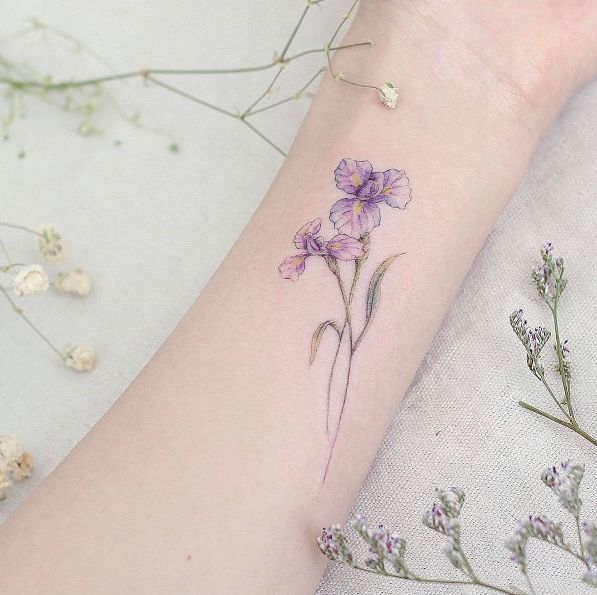 Iris flowers on wrist by Mini Lau