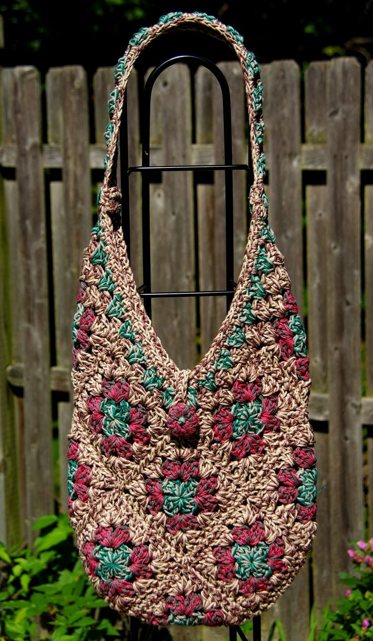Crochet. Market Bag.  Looks like it's majorly granny squares with a few triangles thrown in for good measure.  (Inspiration only)