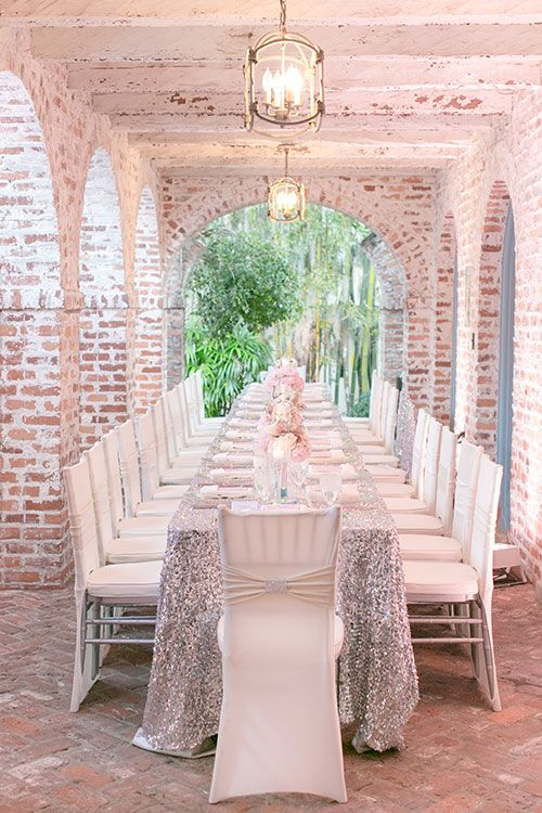 Try a silver glitter tablecloth for your reception tables | Brides.com