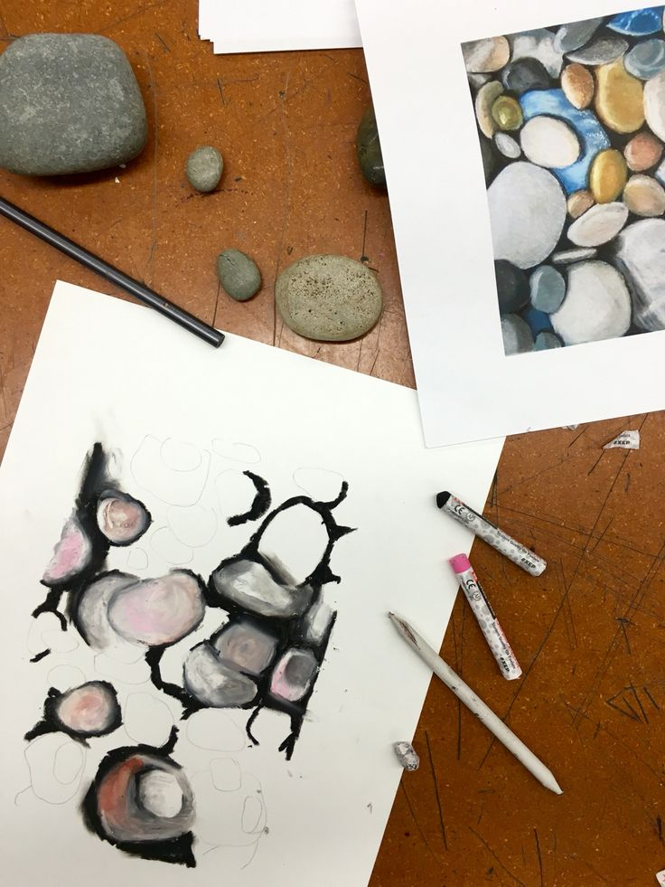 Oil pastel stones- we looked at an existing image on Pinterest and set up our drawing on tagboard. For blending, we used smudge sticks and our fingers.