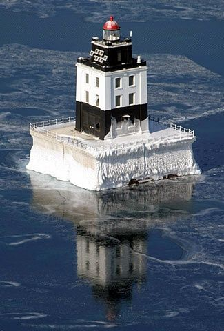 Poe Reef Lighthouse, located in waters south of Bois Blanc Island, 6 1/2 miles northeast of Cheboygan, Michigan--LHF-history