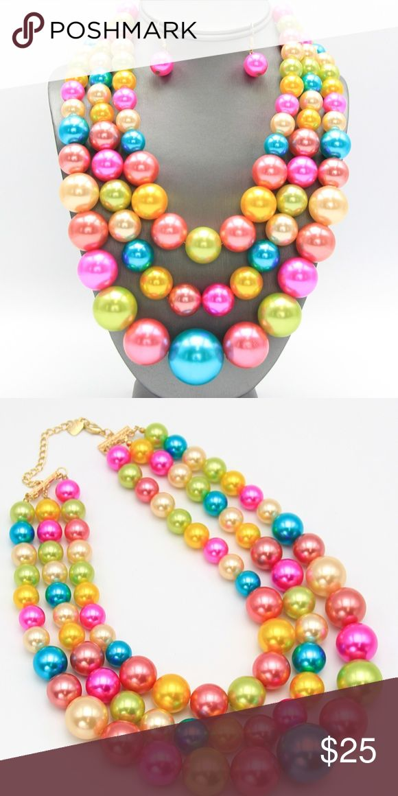 Jumbo Multi-Strand Pearl Necklace Multi-strand pastel faux pearl necklace. Necklace is 16 inches plus 3 inch extender. Jewelry Necklaces