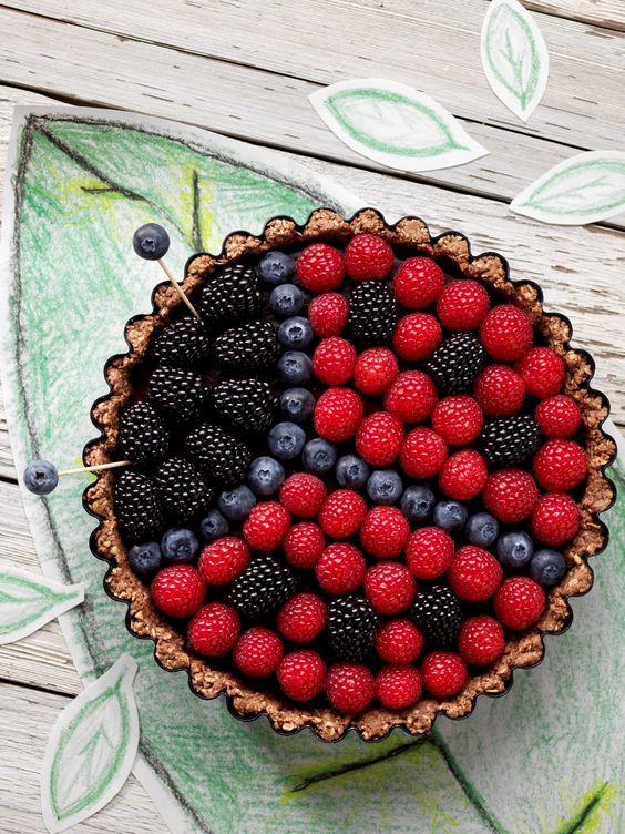 Beautiful ladybug fruit tart! Perfect for a ladybug birthday party, or any spring or summer celebration. Made with blackberries, blueberries, and raspberries.