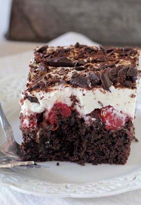 Recipe for Black Forest Poke Cake - This Black Forest Poke Cake is a gooey chocolate cake filled with hot fudge and cherry pie filling. It is topped with fresh whipped cream and chocolate shavings.