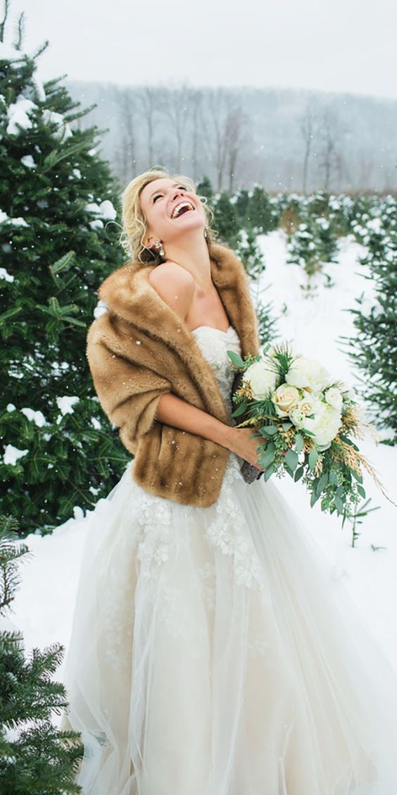 Brown Faux Fur Winter Bridal Wrap / http://www.deerpearlflowers.com/faux-fur-winter-wedding-ideas/